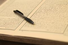 Pen and book on the table royalty free stock images