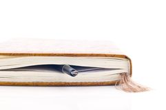 Pen bookmark. A fountain pen used as a bookmark for a book or diary, white background Stock Image