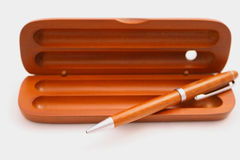 Pen and box. On the white background Royalty Free Stock Image