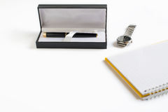 Pen in box with empty book and clock watch royalty free stock image