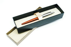 Pen in box. On white background Royalty Free Stock Image