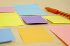 Pen and Bright Sticky notes Stock Photos