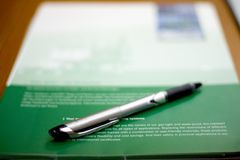 Pen and brochure. Pen sits on a brochure Stock Photo