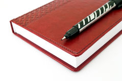Pen and brown diary. On the white background royalty free stock photos