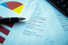 Pen with business charts, reports background for financial and business concepts royalty free stock photo