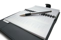 Pen on business day planner. Closeup of a business day planner with a pen royalty free stock images