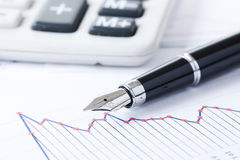Pen and business graph Stock Images