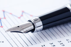 Pen and business graph Stock Photo