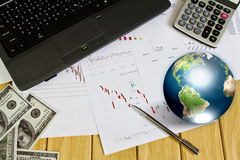 Pen and business graph with earth. Stock Photo