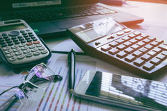 Pen with business graphs and charts report , calculator on desk of financial planing. Financial abstract . Royalty Free Stock Image