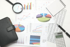 Pen, business items, and business documents with numbers and charts. Concept of workplace of the businessman Royalty Free Stock Photography