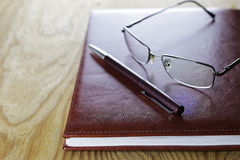 Pen business wallet glasses notebook Stock Images