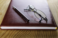 Pen business wallet glasses notebook Royalty Free Stock Image