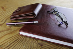 Pen business wallet glasses notebook Stock Photo