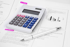 Pen and Calculator Royalty Free Stock Photos