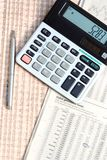 Pen and calculator. Stock Photos