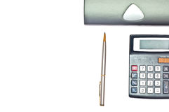 Pen and calculator Stock Images