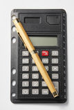 Pen and a calculator Stock Image