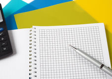 Pen with a calculator. On the folders for papers Stock Image