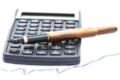 Pen and Calculator. A pen on a calculator on a graph  on white Stock Image