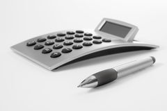 Pen and calculator Stock Photos