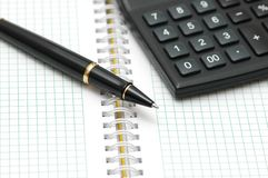 Pen and calculator. With shallow depth of field Royalty Free Stock Photos