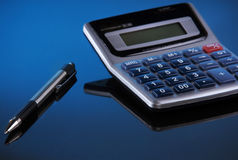 Pen and calculator Stock Image