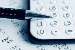 Pen and calculator. Stock Photography