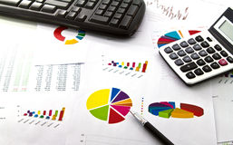 Pen, calculator and business graph Stock Images