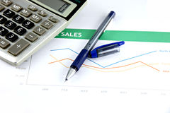 Pen and calculator on business graph. Stock Images