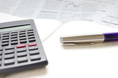 Pen, calculator and business paper. Business concept; calculator, pen and notebook on financial paper, macro, shallow DoF Stock Image