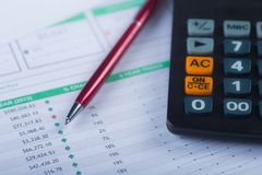 Pen and Calculator on Cash Financial Spreadsheet. Pen and calculator on a financial spreadsheet cash statement with columns of numbers for an accounting budget Stock Photography