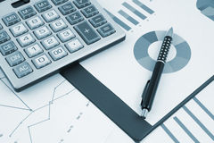 Pen and calculator on documents Stock Photos