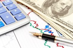 Pen,calculator and dollars on chart closeup. Stock Photo