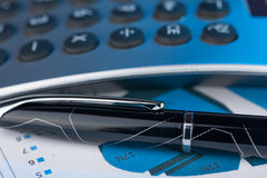 Pen,calculator and dollars  closeup. Royalty Free Stock Photos