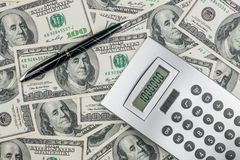 Pen,calculator and dollars  closeup. Stock Images