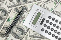 Pen,calculator and dollars  closeup. Stock Photos