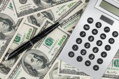 Pen,calculator and dollars  closeup. Business concept Stock Photo