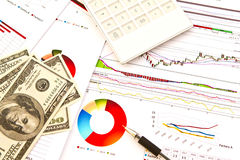 Pen ,calculator and dollars and financial Graphs Stock Photography