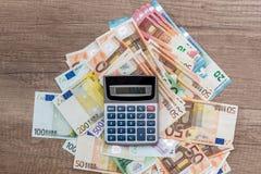 pen calculator and euro banknotes stock photos