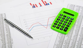 Pen, calculator and finance Royalty Free Stock Images