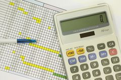 Pen and calculator for financial calculating Stock Photo