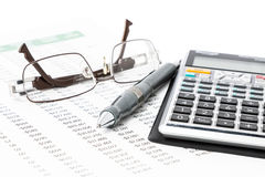 Pen, Calculator and glasses Stock Images