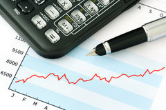 Pen and Calculator on Graph. Pen and Calculator on Blue Graph Stock Photography