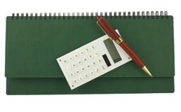Pen and calculator on green organizer. Top view Royalty Free Stock Photos
