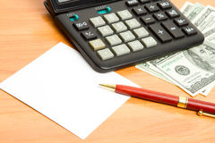 Pen, calculator and money close up. Stock Photography