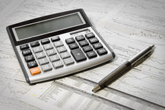 Pen, Calculator And Newspaper Stock Photo