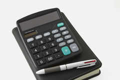 Pen and calculator and notebook Royalty Free Stock Images