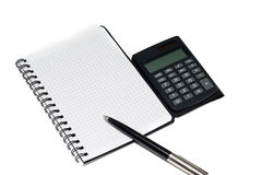Pen and calculator with notepad Royalty Free Stock Photography