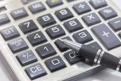 Pen and calculator in office Royalty Free Stock Image